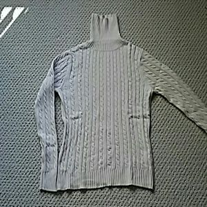 Knit sweater with cotton, nylon blend.